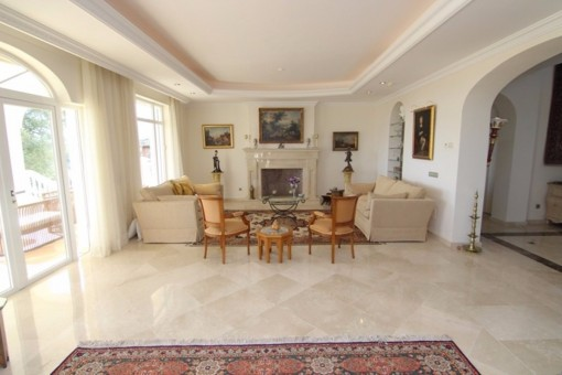 The elegant living room with open chimney and marble floor