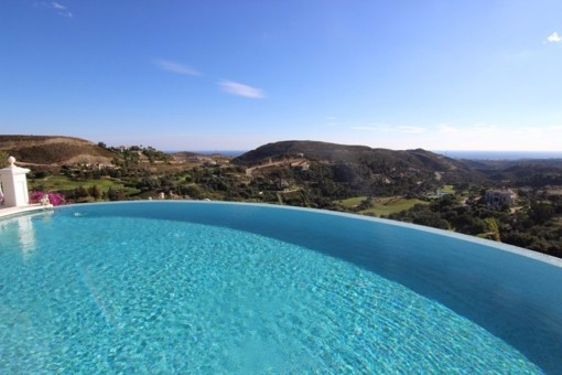 The crystal clear infinity pool with views to the coast