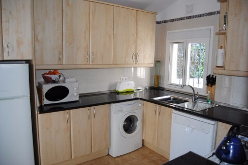The bright, fully fitted kitchen