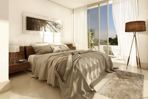 One of the stylish bedrooms with direct access to the terrace