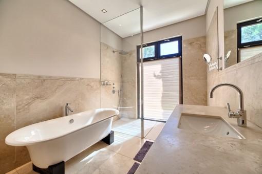 Designer guest bathroom with bathtub