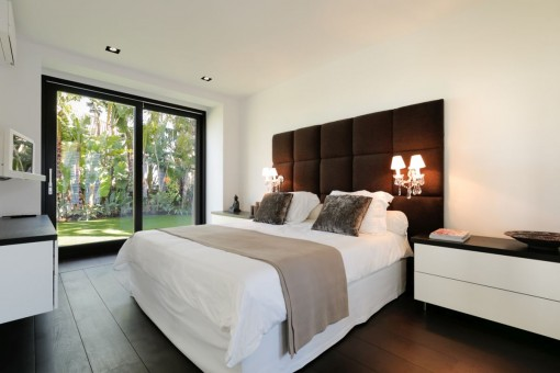 One of the designer guest bedroom with access to the garden