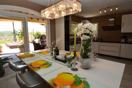 Another dining area with chandelier and access to the kitchen