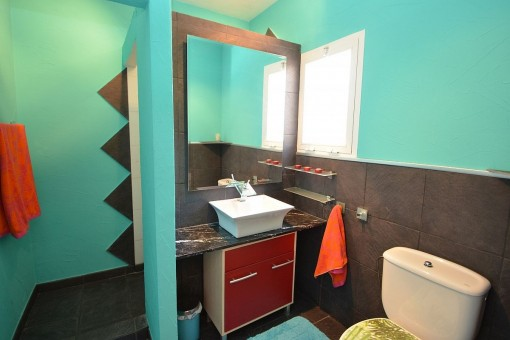 Further bathroom with washbasin and large mirror
