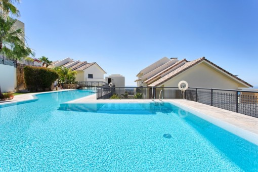 Spacious pool area with a large pool