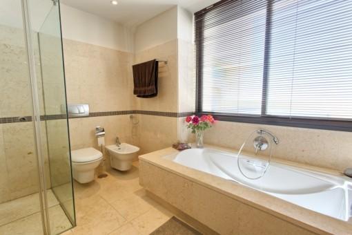 Master bathroom with bathtub and shower