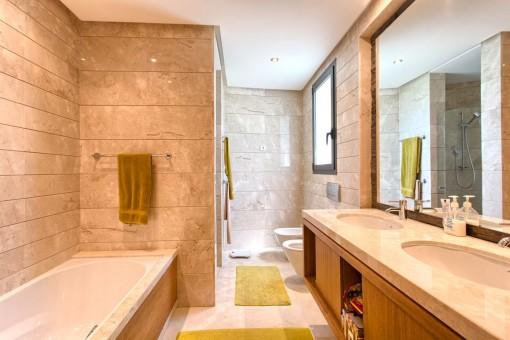 Spacious main bathroom with bathtub and shower