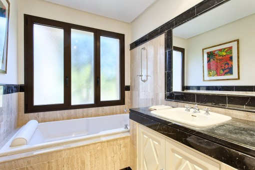 Modern bathroom with bathtub and washbasin