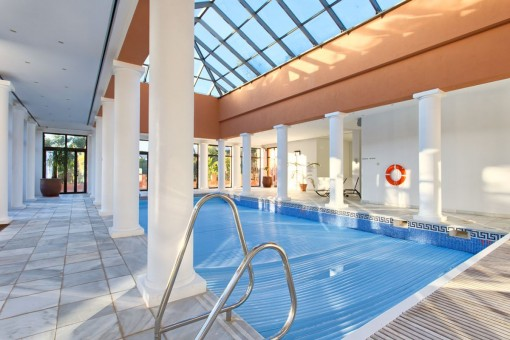 The living area offers a indoor pool with fitness and spa