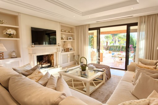 Cosy living area with carpet flooring and access to the terrace