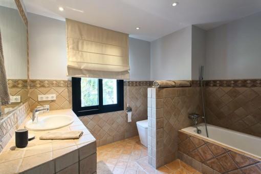 Bright guest bathroom with bathtub