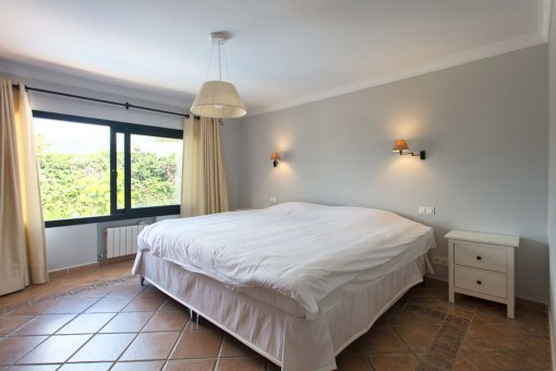 Elegant guest bedroom with double bed