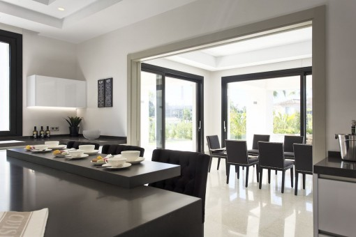 Views from the modern kitchen to the dining area