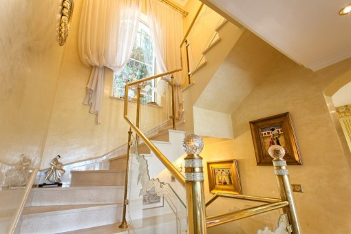 Elegant staircase with glass railings