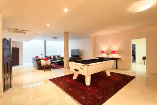 Generous living area with billiard table