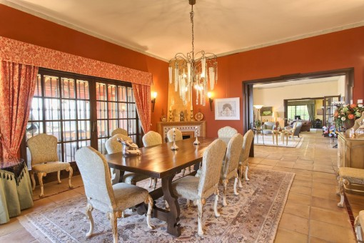 Dining area with chandelier and fireplace