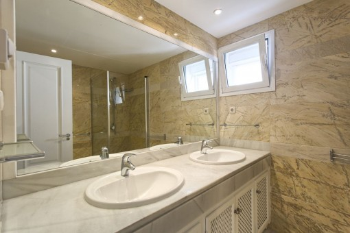 Bright bathroom with 2 washbasins