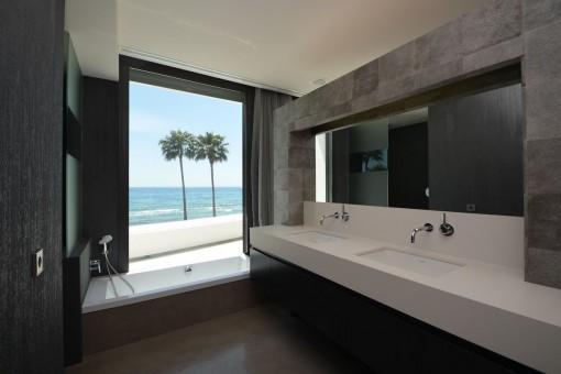 Modern bathroom with sea views