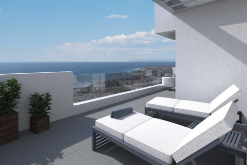 Large terrace with sunbeds and stunning views