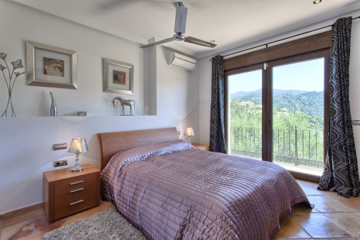 Another bedroom with direct access to the terrace