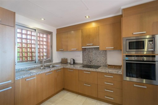 Fully equipped kitchen with timbering