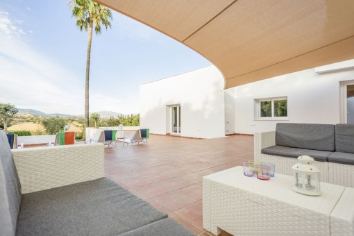 Large terrace with access to the pool