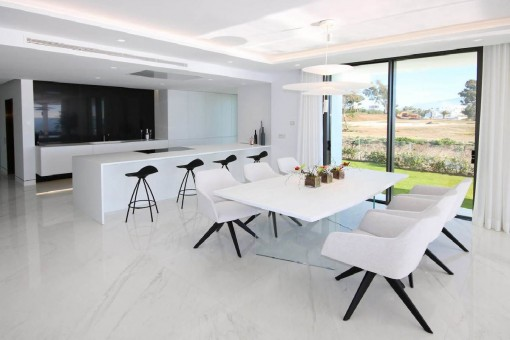 Bright dining area with open kitchen