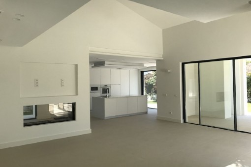 Open living area with kitchem