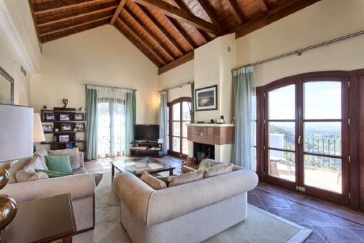 Living area with high ceiling and fireplace