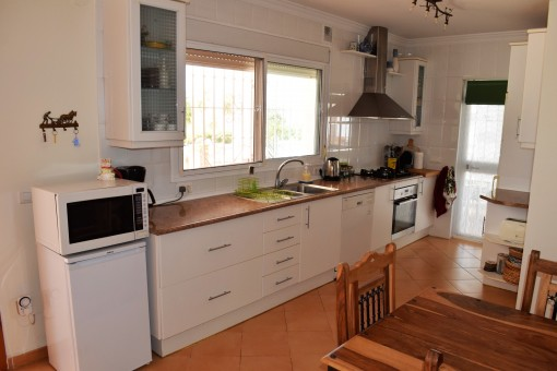 Spacious kitchen with access to the terrace