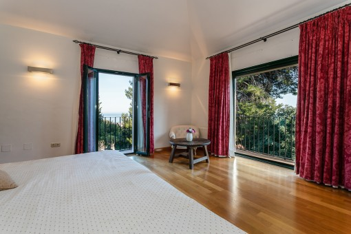 The bedroom offers stunning sea views